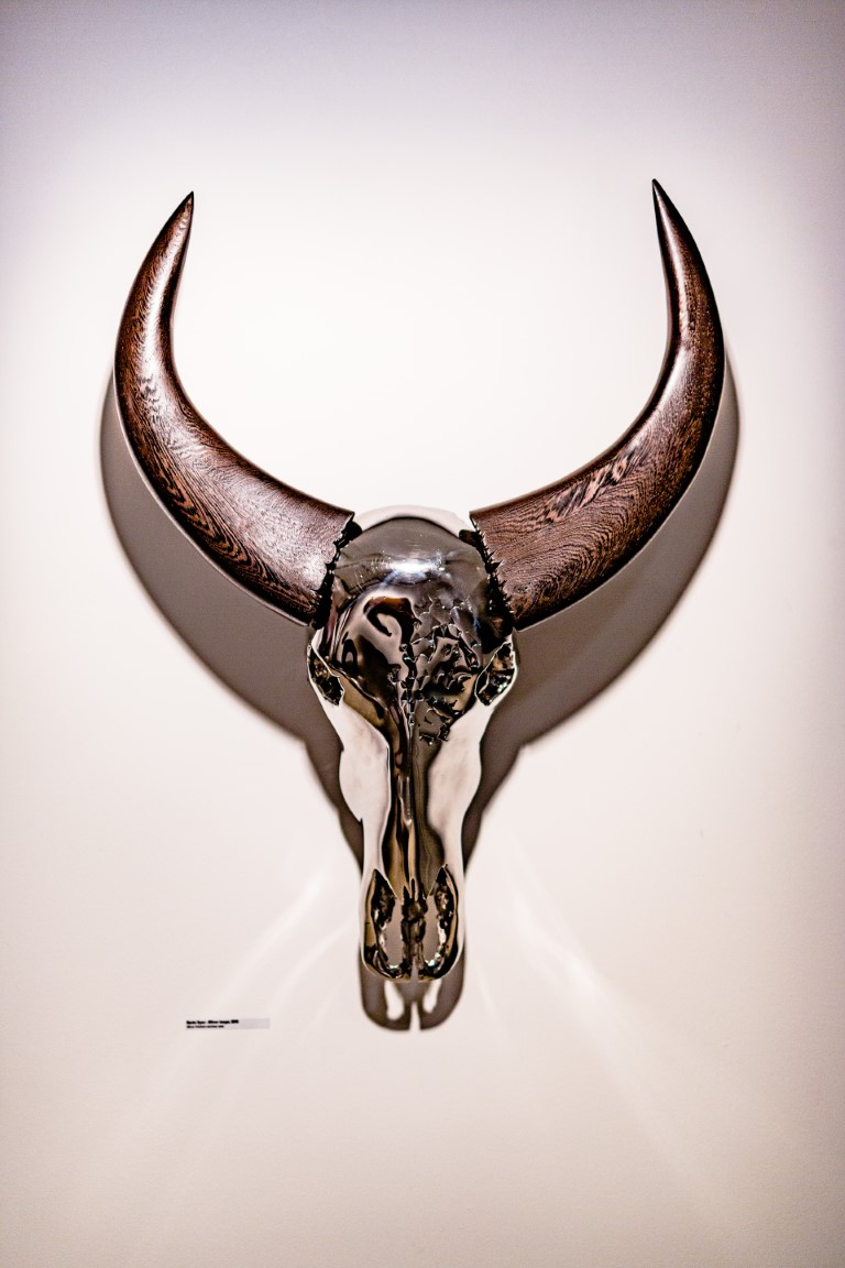 """Mirror image"", mirror polished stainless steel + wengé wooden horns, created by Kevin Oyen"