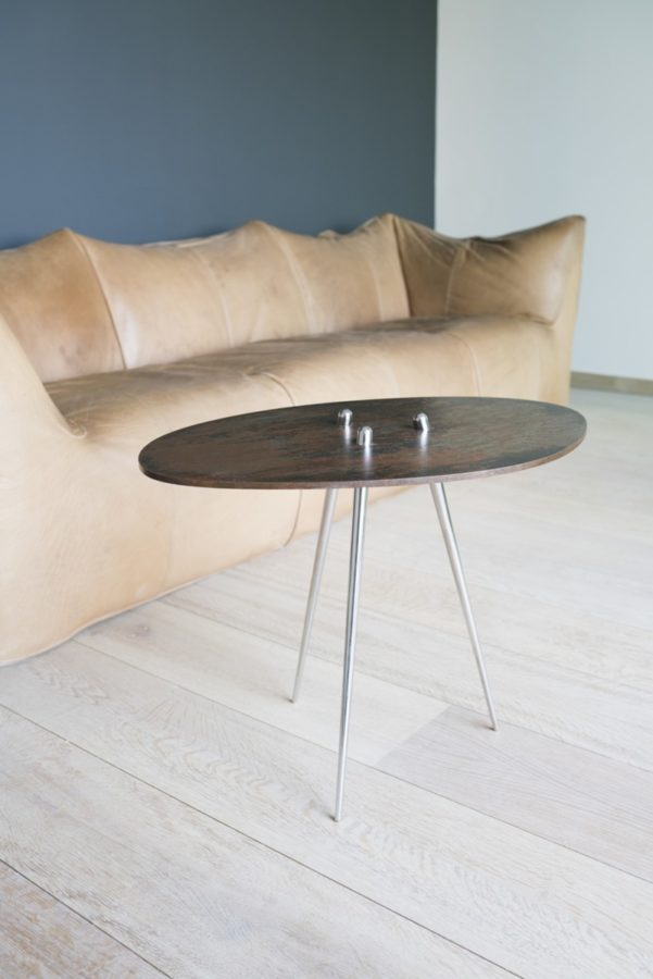 Time table, polished Stainless steel legs with patinated steel tabletop. Created by Kevin Oyen, designer and artisan metalworker